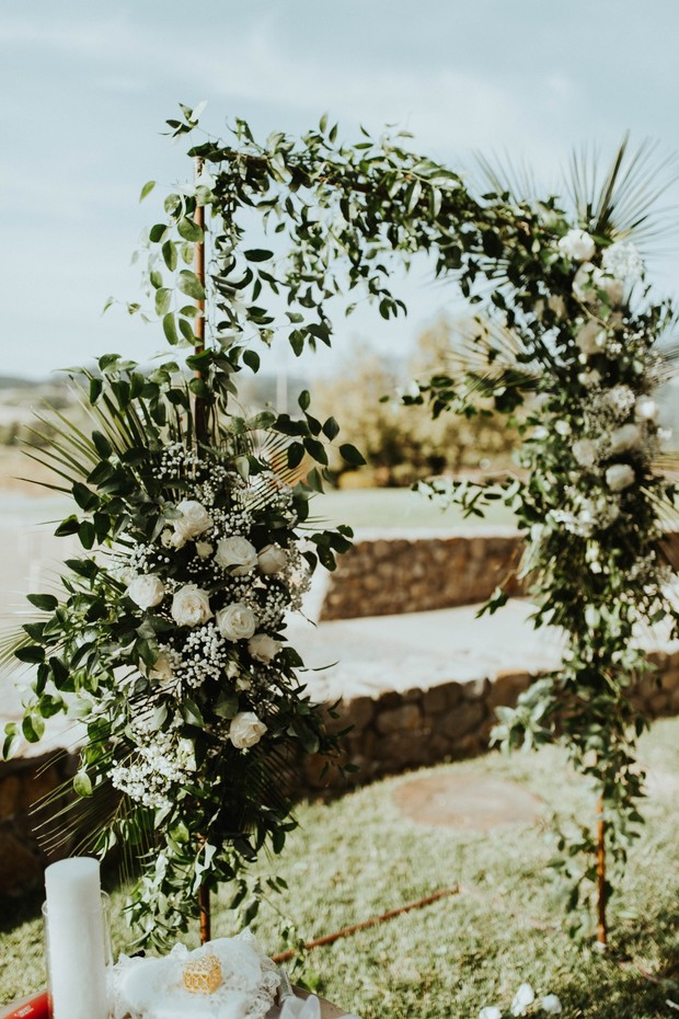 wedding ceremony backdrop with greenery
