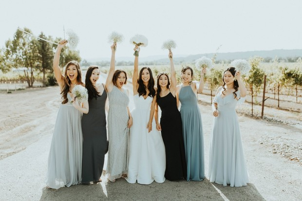 bridesmaids in mismatched blue gowns