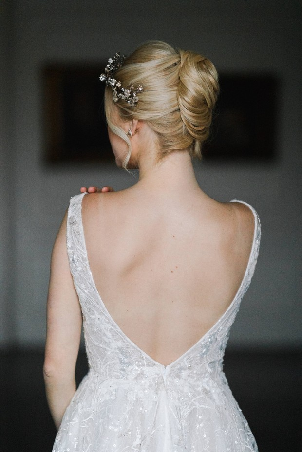 wedding updo with low back wedding dress
