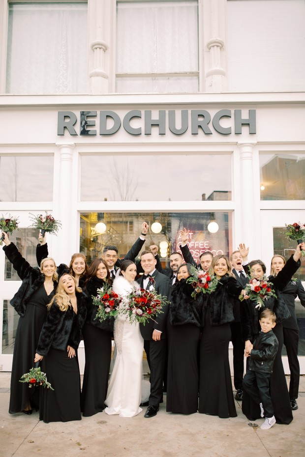 bridal party in black dresses and fur