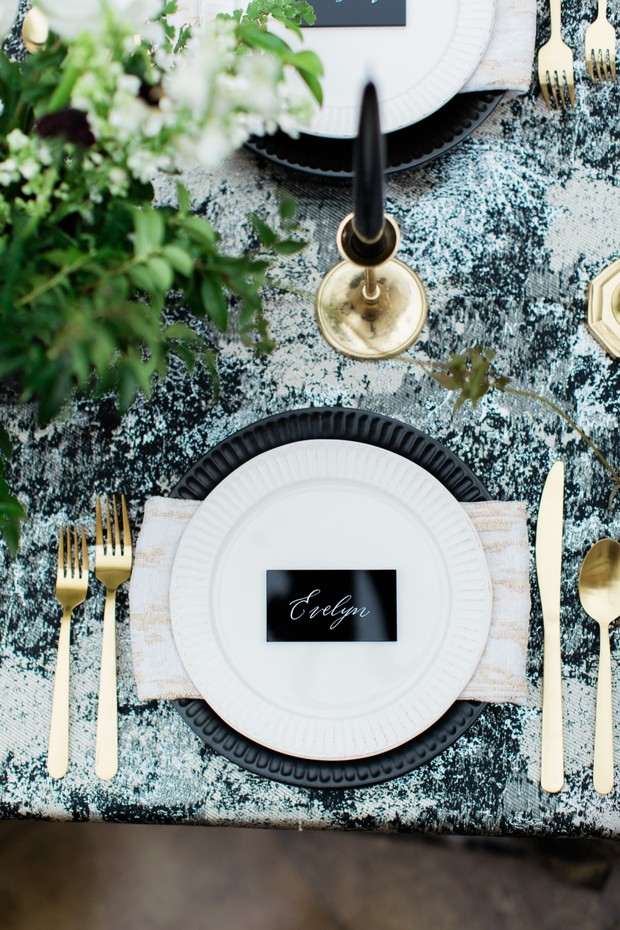 black and gold elegant place setting