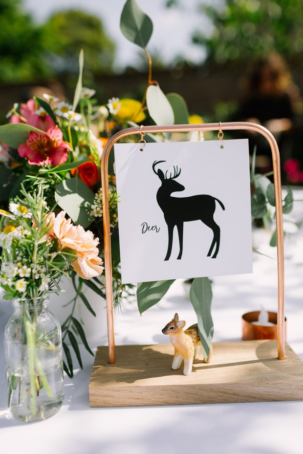 cute table name and deer statuette