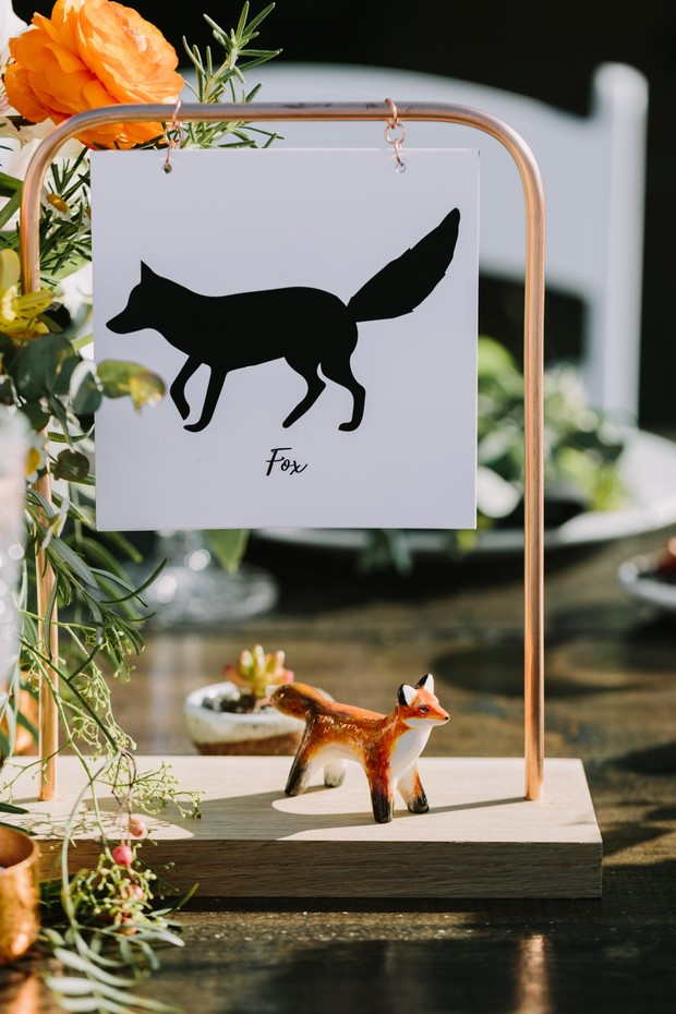 wedding table names and cute animal statuettes