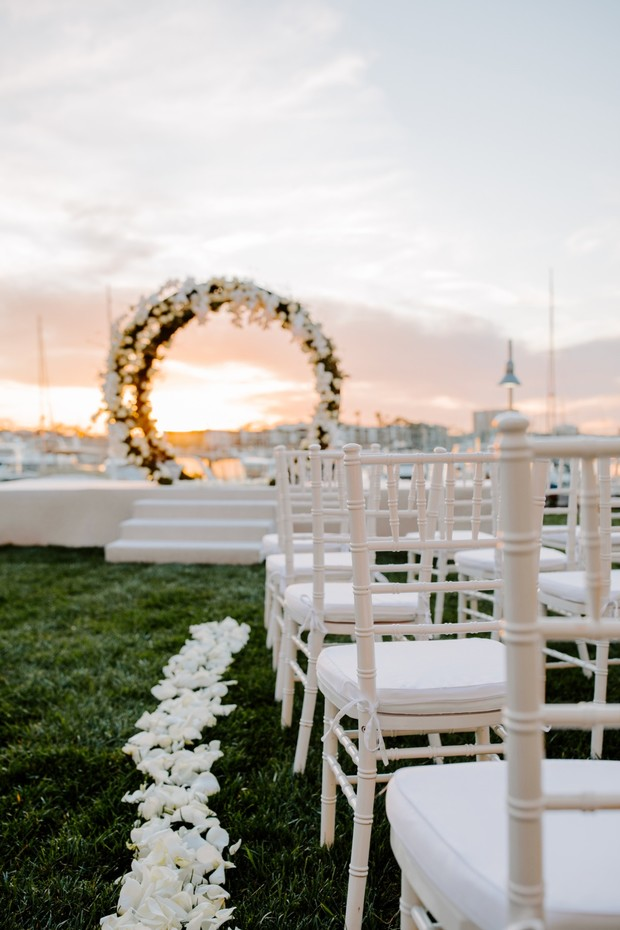 outdoor wedding ceremony at sunset
