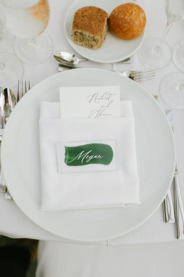 simple and chic wedding place setting in white and green