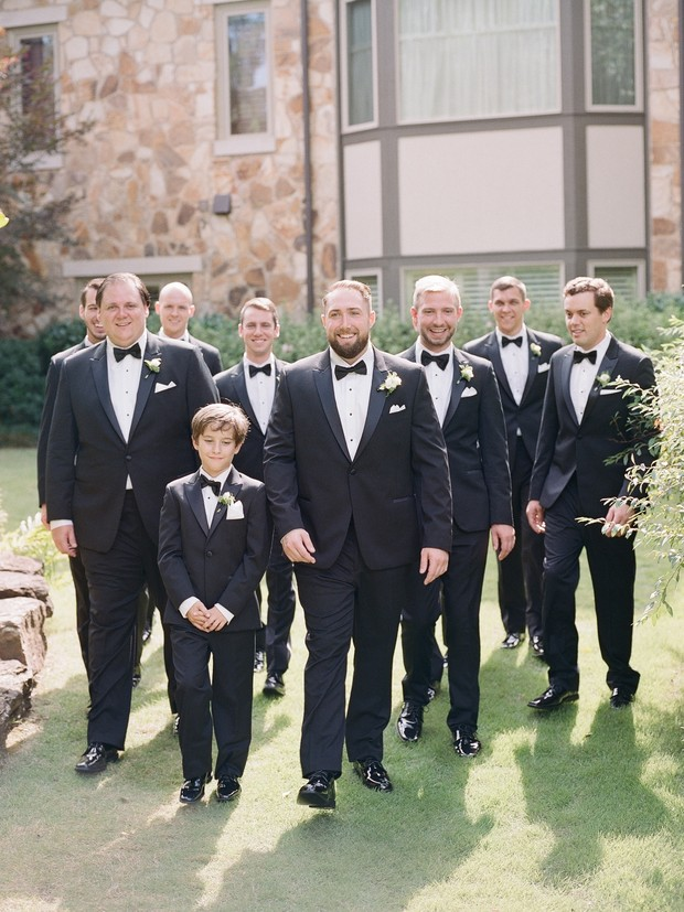 groom and groomsmen in classic black suits