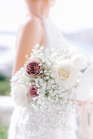 white and purple rose and babies breath wedding bouquet