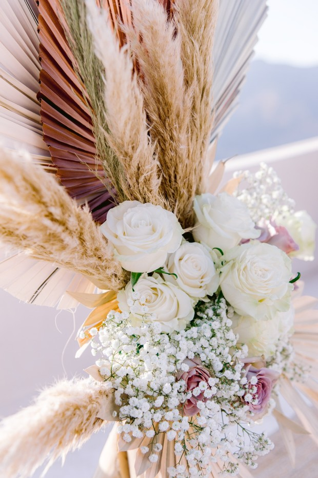 white rose and babys breath wedding floral decor
