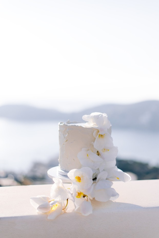 white orchid topped wedding cake