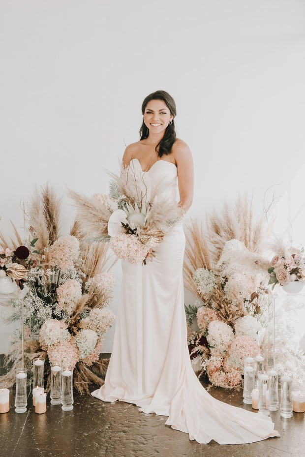 neutral soft floral backdrop for your wedding ceremony