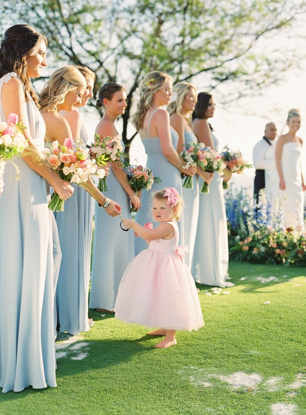 pastel blue bridesmaids and pink flower girl