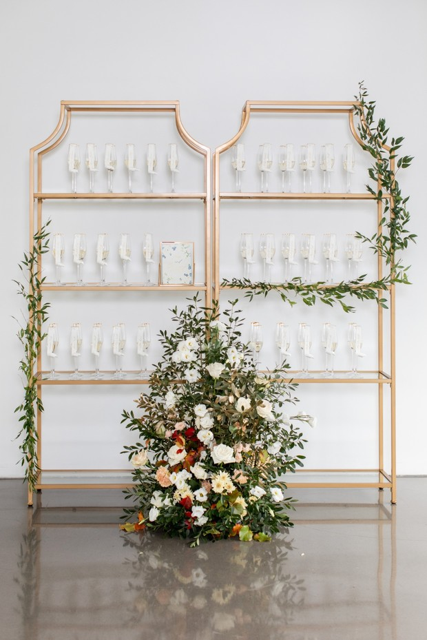 wedding seating chart with champagne glasses