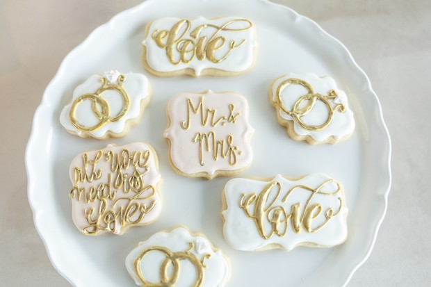 wedding cookies with gold icing