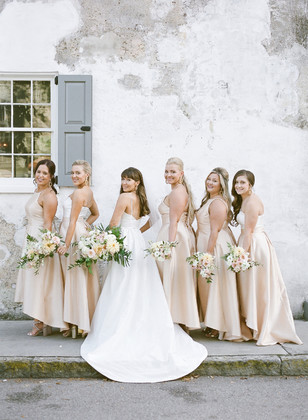 bridesmaids in soft champagne high low dresses