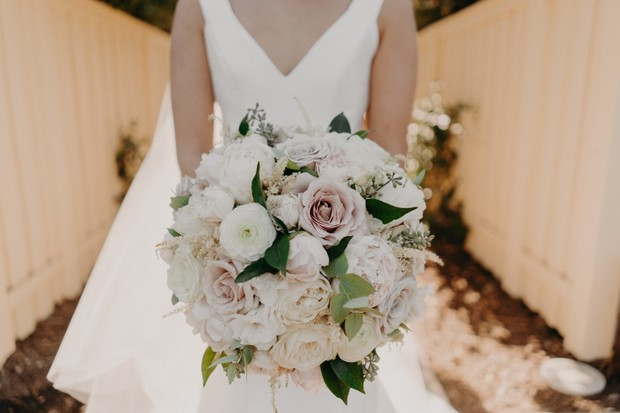 white and blush wedding bouquet with green accents