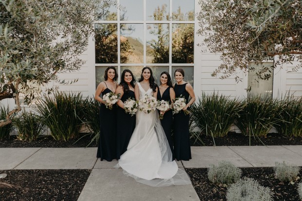 black bridesmaid dresses with peony and rose bouquets