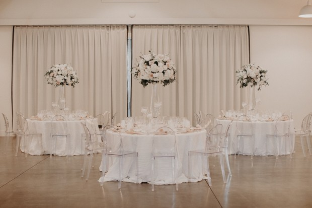elegant wedding reception with ghost chairs