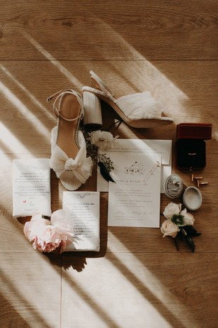 flat lay styling of invites and shoes