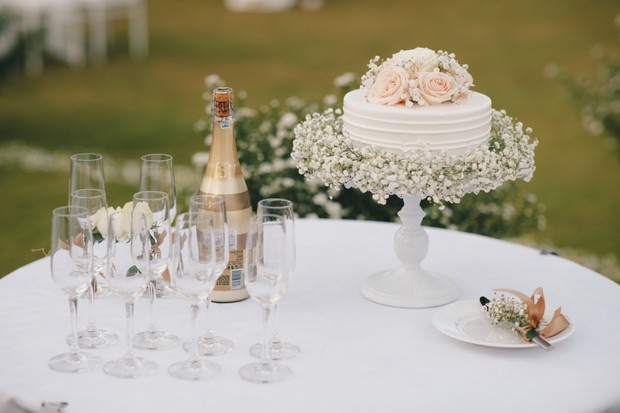 wedding cake decorated with baby's breath