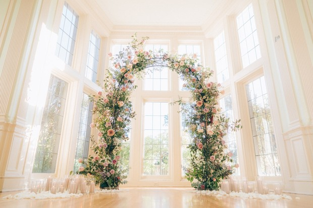 floral wedding arch decorated with candles