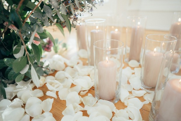 candles surrounded by rose petals