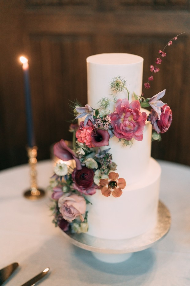 white wedding cake adorned with fresh florals