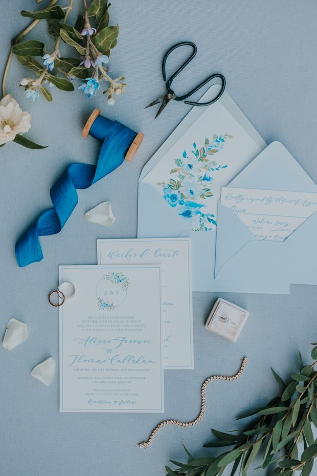 blue wedding invitations with flat lay styling