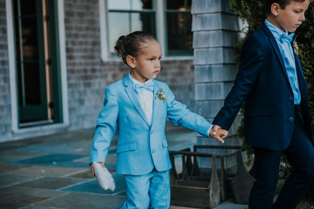 ring bearer in blue suits