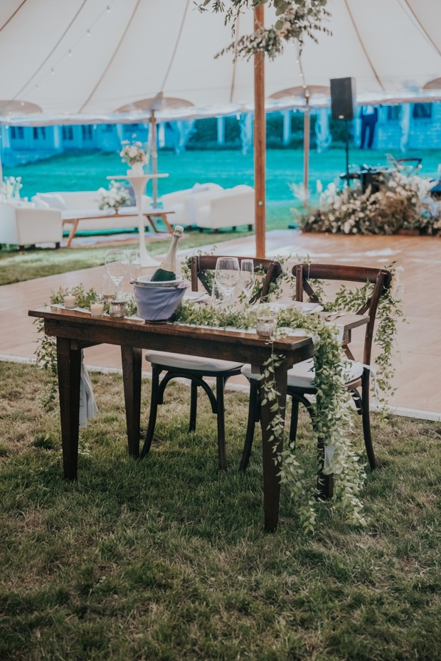 simple sweetheart table with greenery