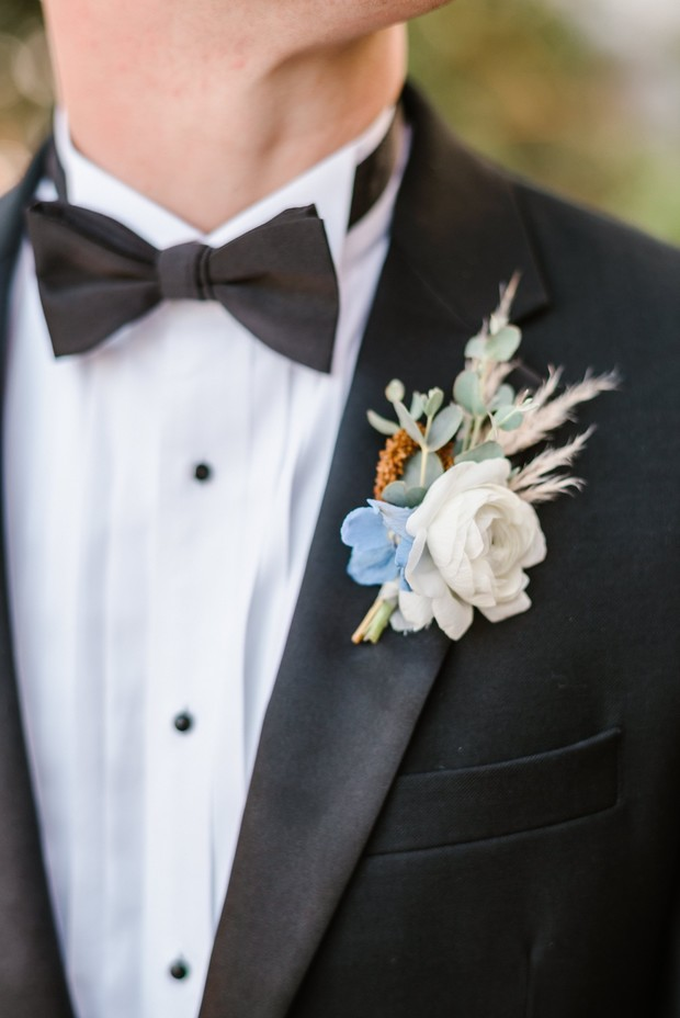 white, blue and green boutonnière