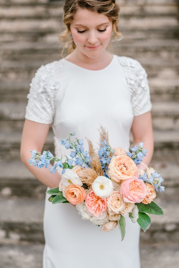 short and tight peachy pink and blue wedding bouquet