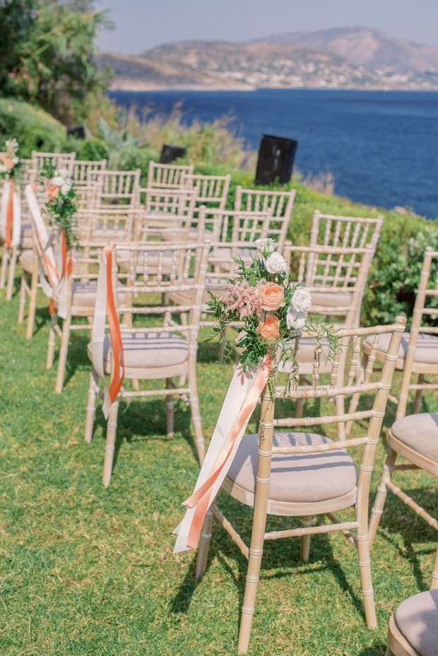 wedding chairs with ribbon and florals