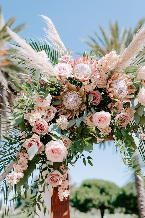protea, roses and eucalyptus wedding arrangement