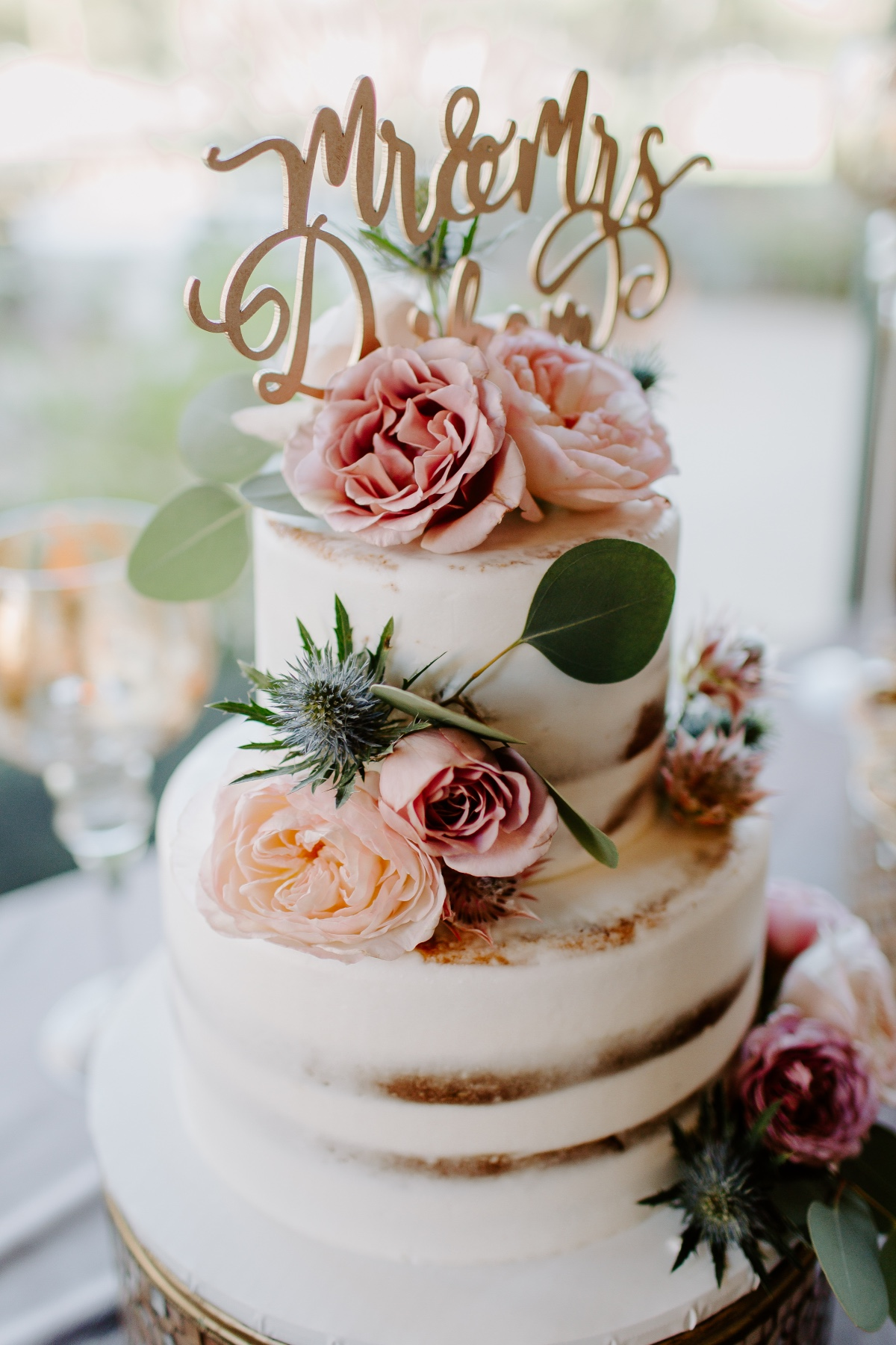 Naked cake with gold cake topper