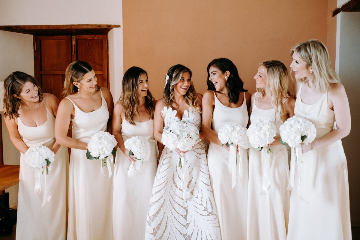 white bridesmaid dresses with hydrangea bouquets