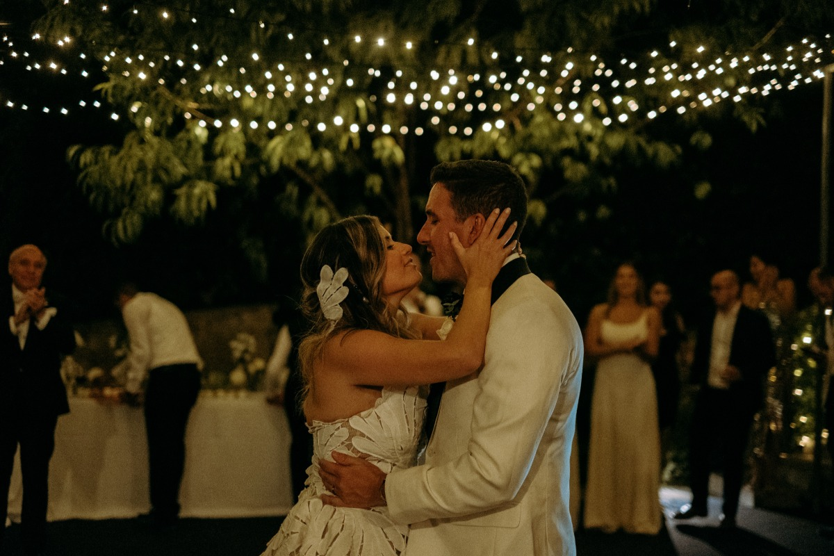 couple dancing at their candlelight wedding reception