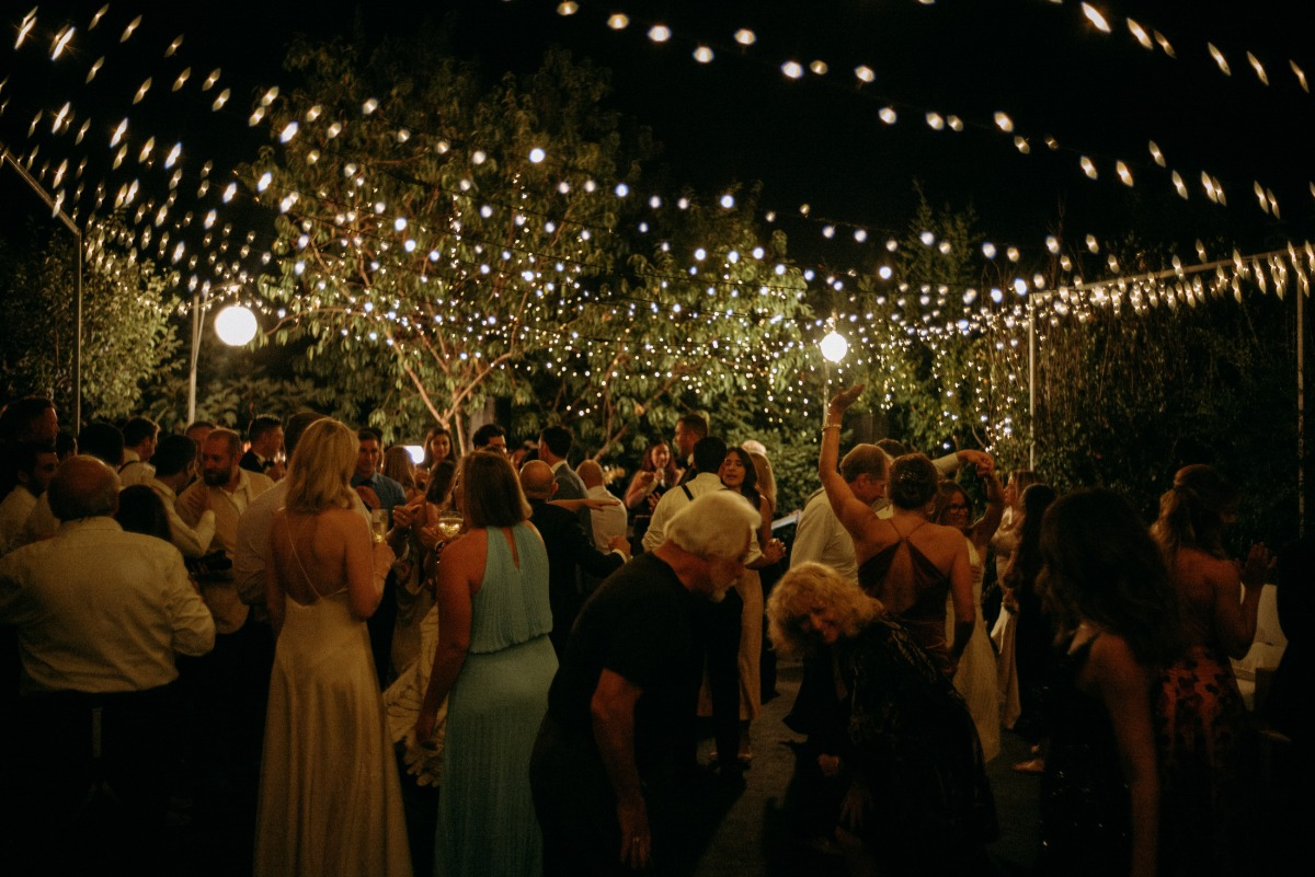 guest dancing at their candlelight wedding reception