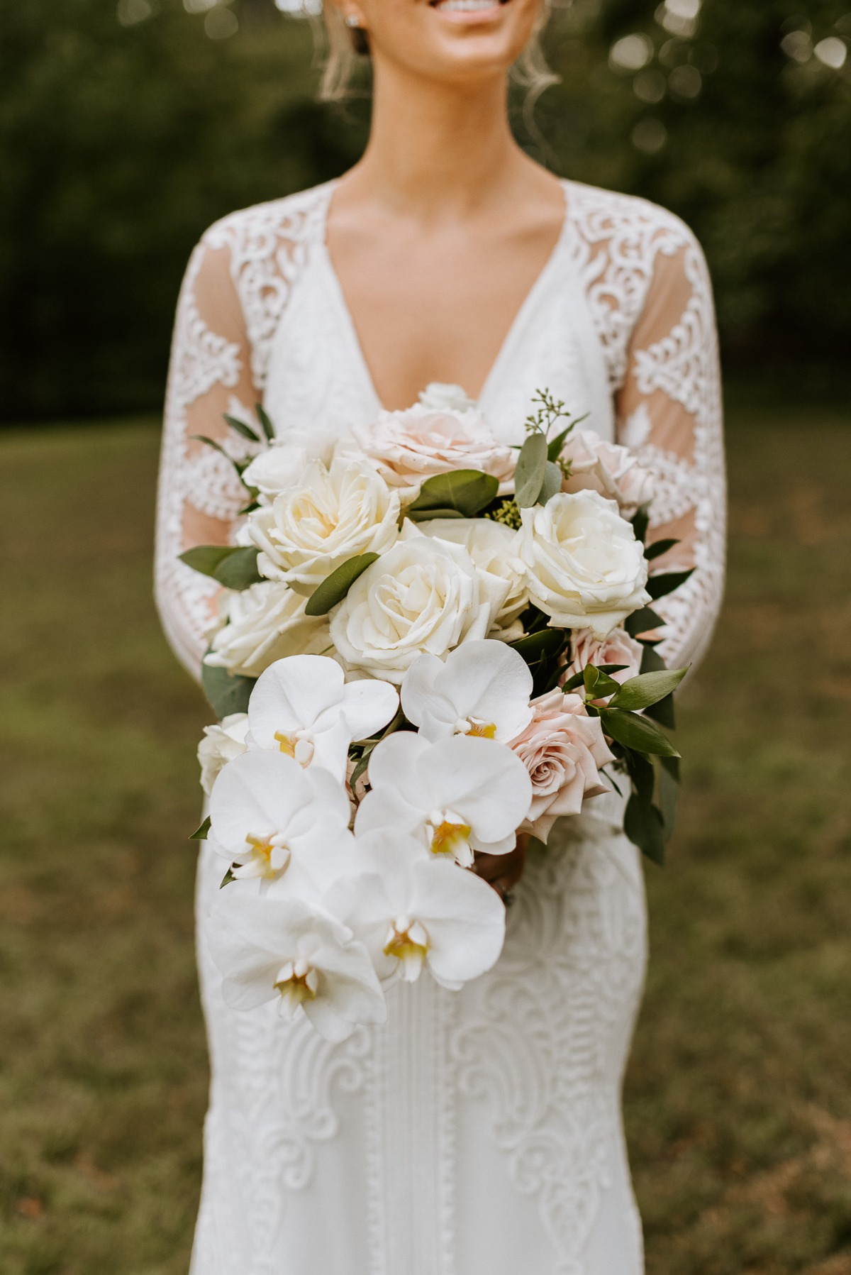 orchid, rose and greenery bouquet