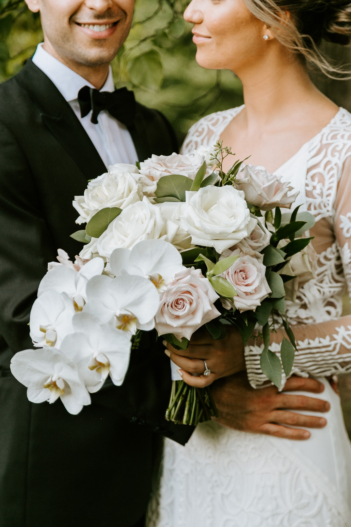 orchid, rose and greenery wedding bouquet