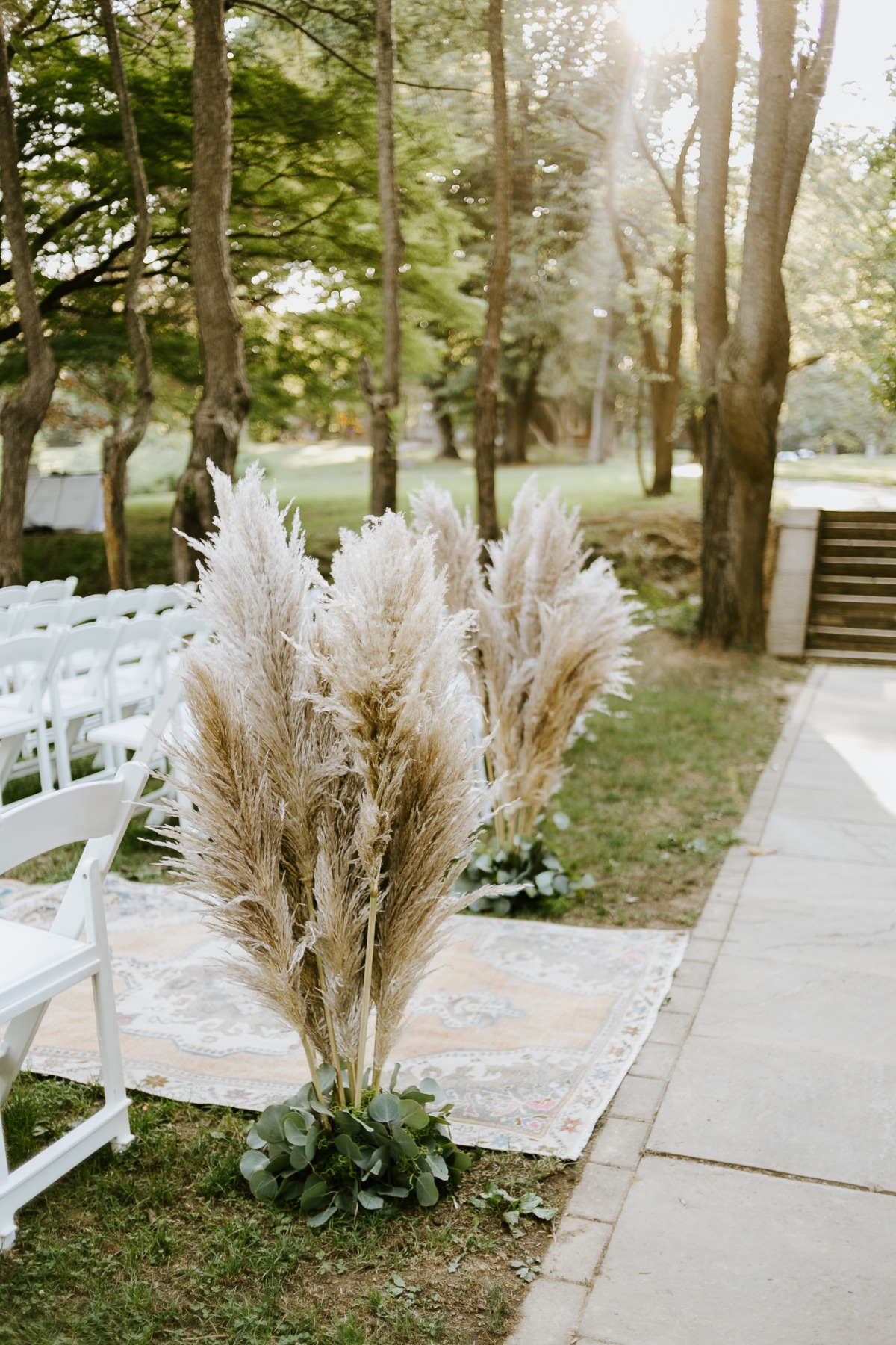 Papas grass surrounded by eucalyptus for ceremony entrance