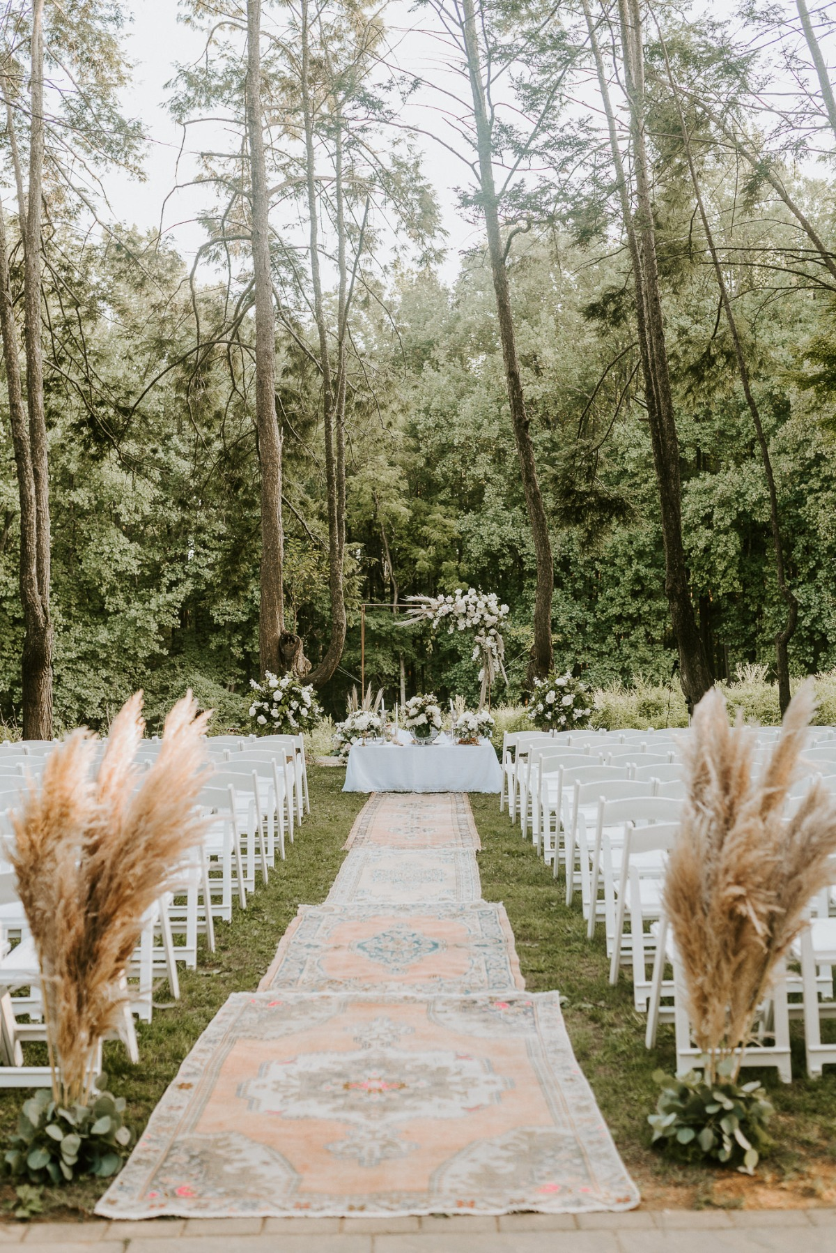 outdoor wedding ceremony with vintage rugs