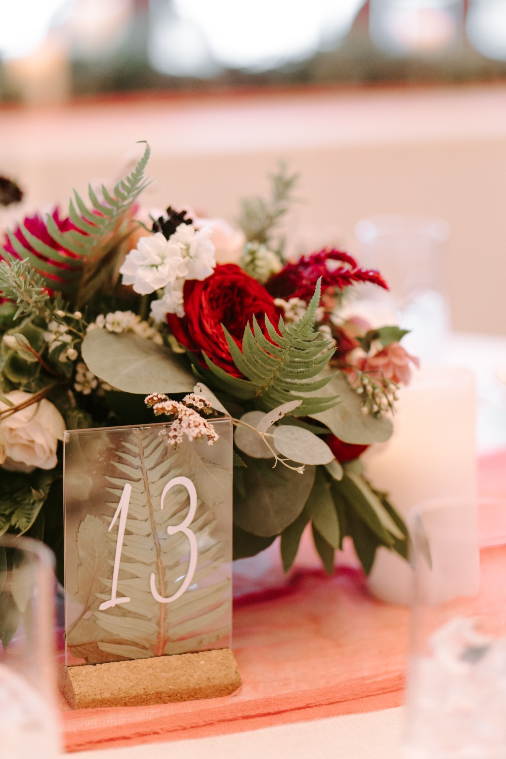 table numbers with plants with greenery in them