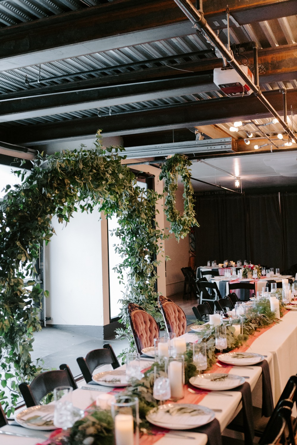Head table surrounded by greenery