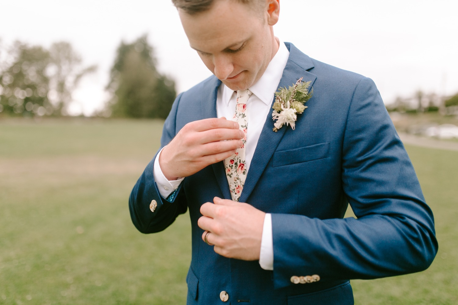 blue suit with floral tie