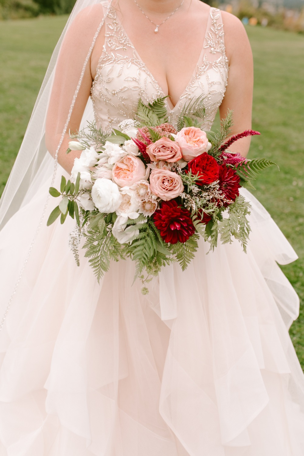 blush pin and red wedding bouquet