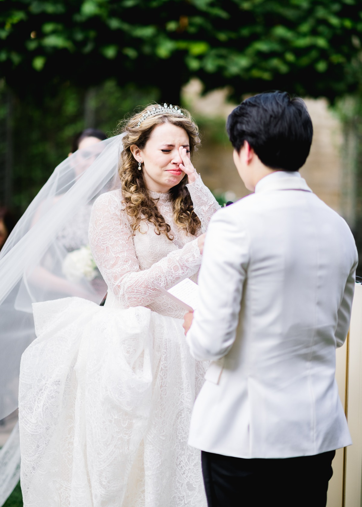 bride crying at her wedding