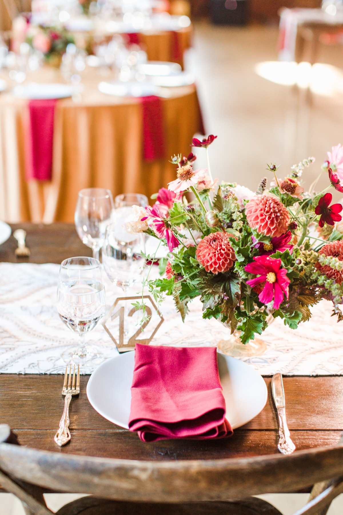 floral arrangement with wooden table numbers