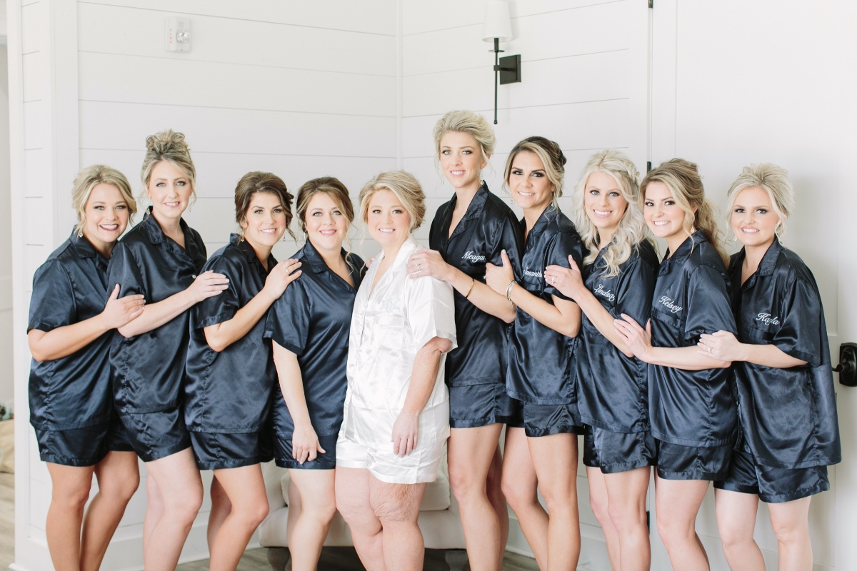 bridesmaid in personalized blue satin getting ready outfits