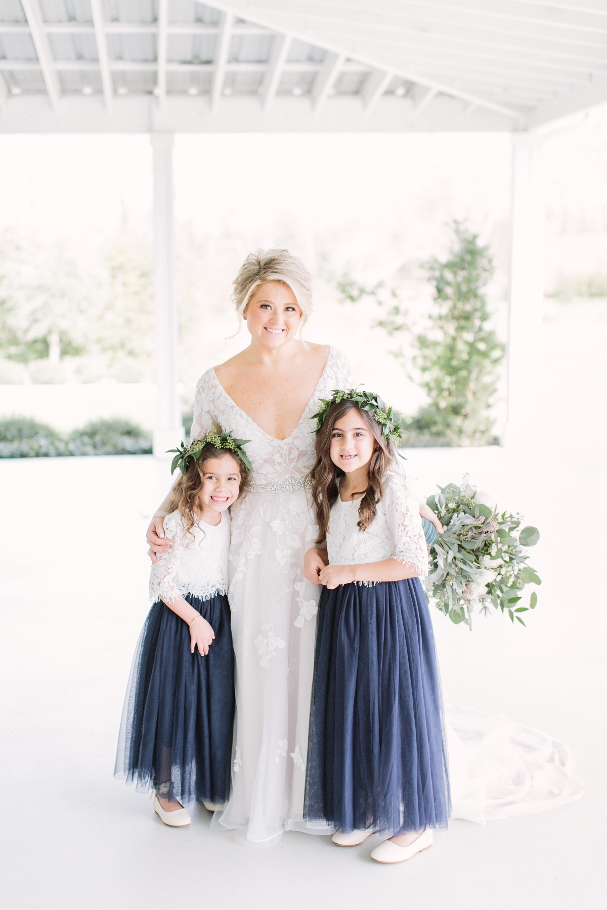 white and blue flower girl outfit idea with greenery floral crowns