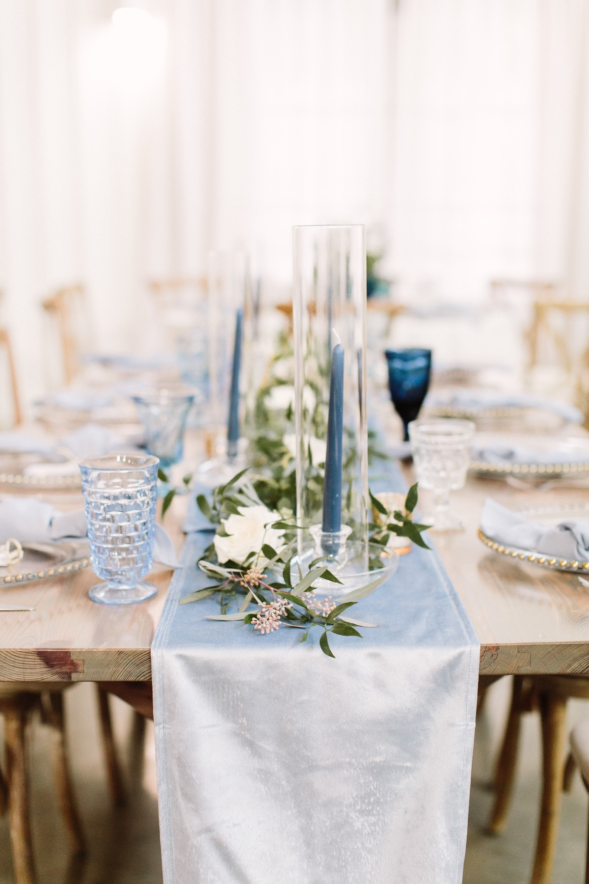 light blue satin table runner with greenery